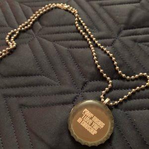 Bottle cap dinosaur necklace